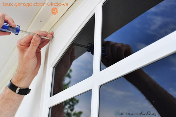 Install Easy DIY Faux Garage Door Windows at your home in no time at all with this step by step guide! And adding faux windows are an inexpensive way to upgrade your home's curb appeal. Delineate Your Dwelling #fauxgaragedoorwindows #curbappeal #garagedoorwindows