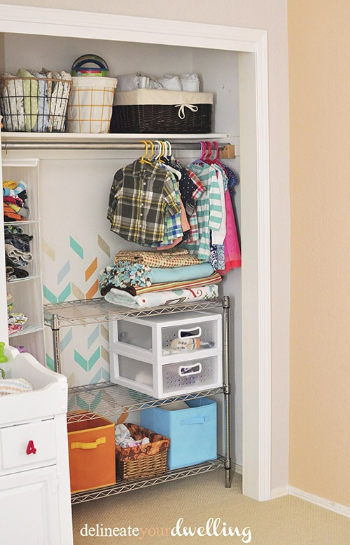 Shared Closet, How to transform a dull unorganized closet into a fun paint herringbone patterned Kid's Closet. Such a huge improvement, check out this easy makeover. Delineate Your Dwelling #kidscloset #paintedherringbone