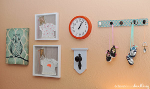 Learn how to make shadowboxes for your children's bedrooms using their baby onesies! I did a little girl and a little boy shadowbox for each of my kiddos. Delineate Your Dwelling #kidshadowbox #onesiecraft #onesieshadowbox