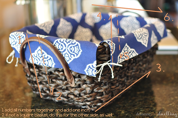 Learn how to line a basket with fabric without any sewing skills needed! Follow these simple instructions and step by step instructions on how to take a wicker basket and make DIY basket liners with no sewing involved. Delineate Your Dwelling #nosewbasketliner #nosewproject #basketliner