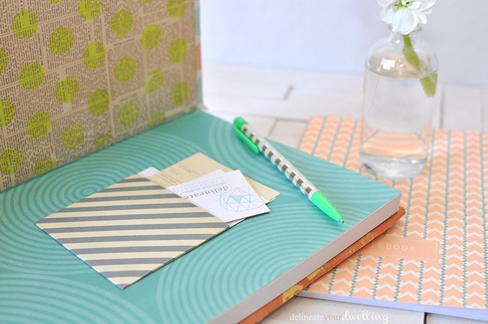 Learn how to customize your notebook cover in a few simple steps using fun and colorful scrapbook paper! Personalize your notebook to reflect your style. Delineate Your Dwelling #customnotebook #DIYnotebook #DIYjournal