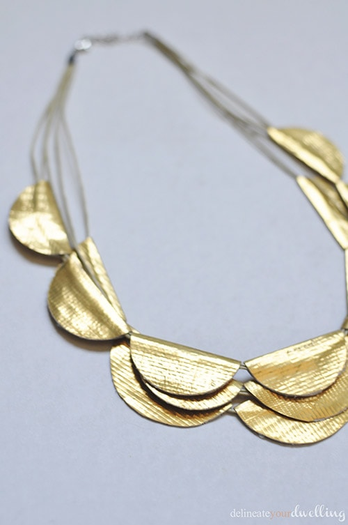 Learn how to make a Gold Scallop Necklace from regular Duck Tape! It's the ultimate DIY craft project and your friends will never know what it is really made of. Delineate Your Dwelling