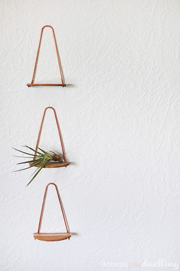 Simple and mini Copper pipe shelves. Fun to make and perfect to hold small decor on your wall. | Delineate Your Dwelling