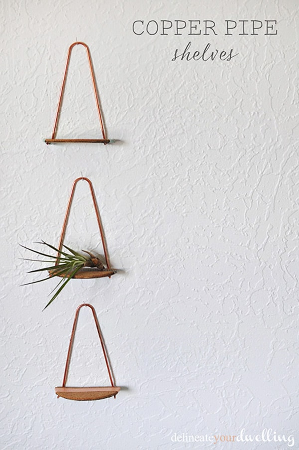 Learn how to create simple but goregous Copper Pipe Shelves using just a few easy materials! You can DIY these small shelves in under an hour.  Fun to make and perfect to hold small decor on your wall. Delineate Your Dwelling