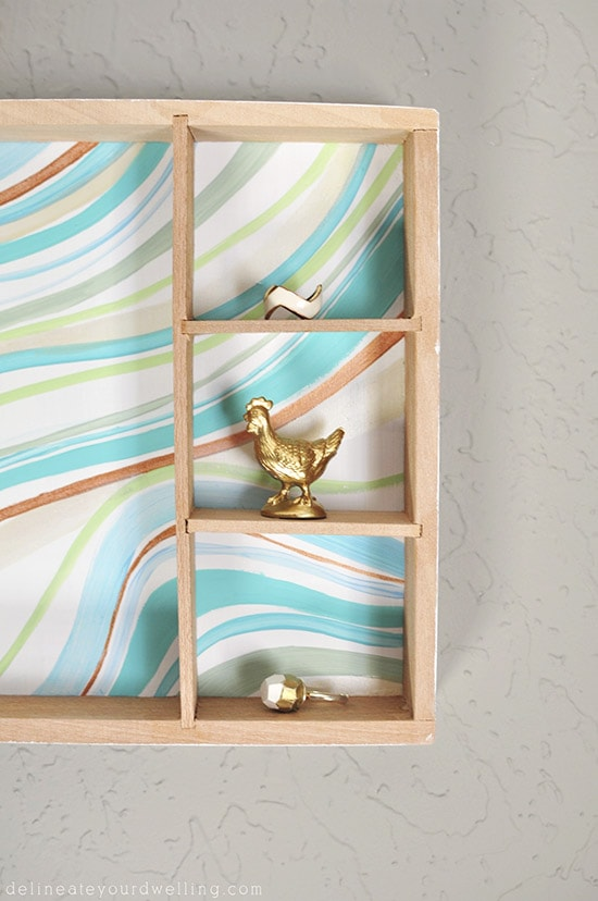 Learn how to create a statement marbled piece using simple acrylic paint and an old wooden toy container. In just a few steps you'll be painting your own Marbled Wall Shadow Box. Delineate Your Dwelling #paintedshadowbox #DIYshadowbox