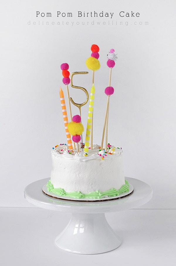 Adorable store bought Pom Pom Birthday Cake