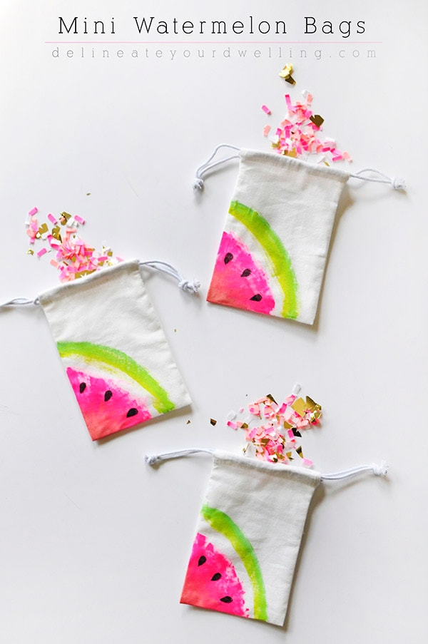 Learn how to make mini painted Watermelon Canvas Bags! They are the perfect craft project for holding a few special treats and they make great gifts, too. Delineate Your Dwelling #minicanvasbag #paintedwatermelon #watermelonbag #paintwatermelon #summercraft #craftwatermelon