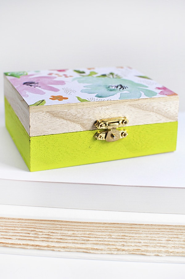 Learn how to create a DIY floral painted wooden box using whimsical scrapbook paper! A simple statement piece for any room in your home. Delineate Your Dwelling #paintedbox #scrapbookpaperbox