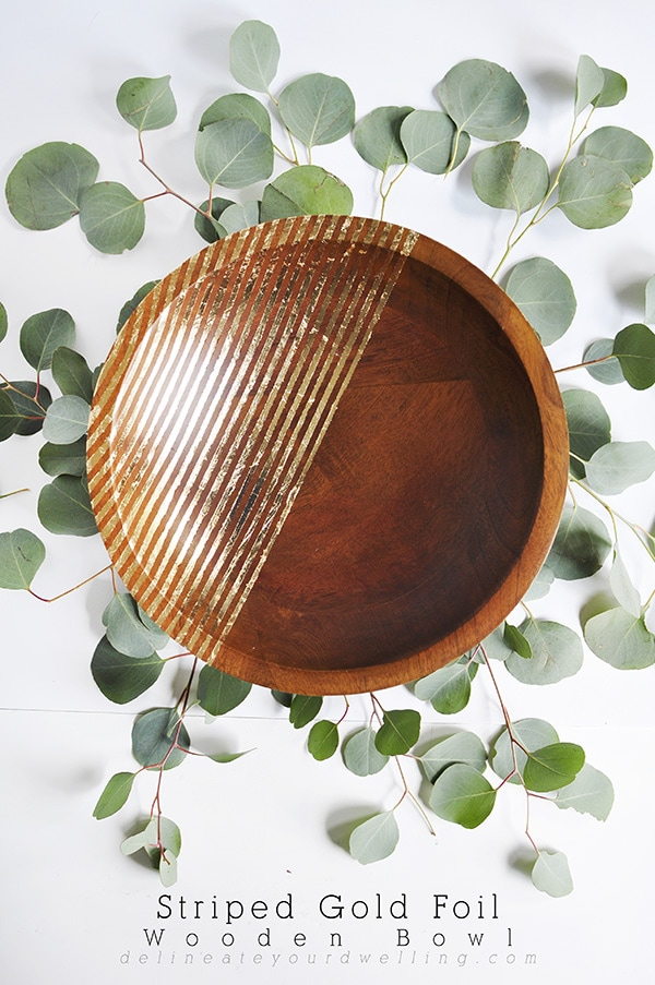 Learn how to create an elegant and unique Striped Gold Foil Wooden Bowl. The perfect DIY project to add a little drama to any piece. Delineate Your Dwelling #goldfoilbowl #goldfoil