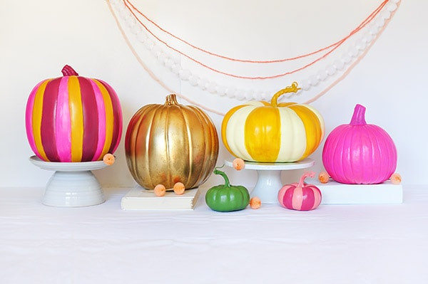 Colorful Painted pumpkins in a row