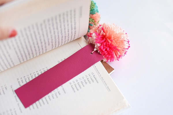 Simple DIY Leather Pom Pom Bookmarks, perfect for kids and adults alike! Delineate Your Dwelling