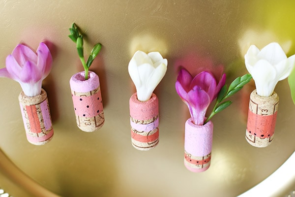 Easiest ever, DIY Mini Cork Flower Vases! Little pops of happy flowers wherever you like. Delineate Your Dwelling
