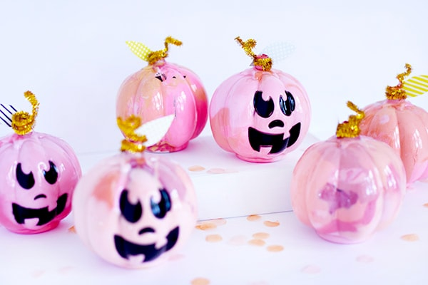 Fun and festive DIY Pink Marbled Pumpkins! Perfect for a table setting or placing on your fireplace mantel during the Fall Season. Delineate Your Dwelling