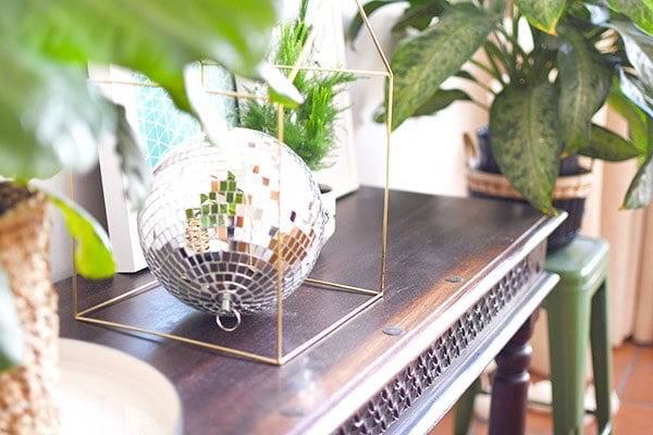 Reasons why you need a Disco Ball in your everyday home decor! Plus, ways to use different sized disco balls, the history behind them and a disco ball shopping resource. Delineate Your Dwelling #discoball #discoballhome #discoballdecor