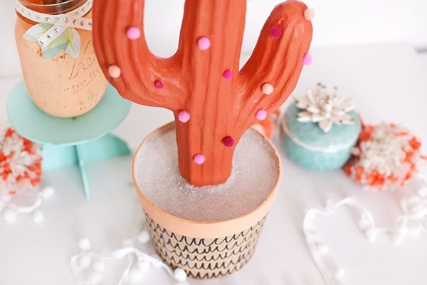 Bring some bold color to your home with a fun DIY Pom Pom Cactus! Delineate Your Dwelling