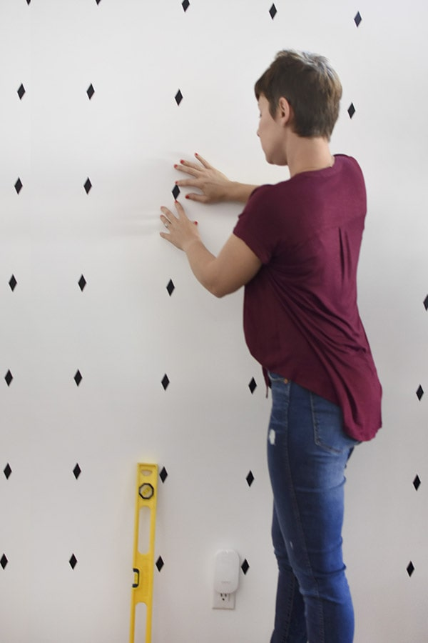 Make quick decals for an inexpensive professional accent wall in dining room.