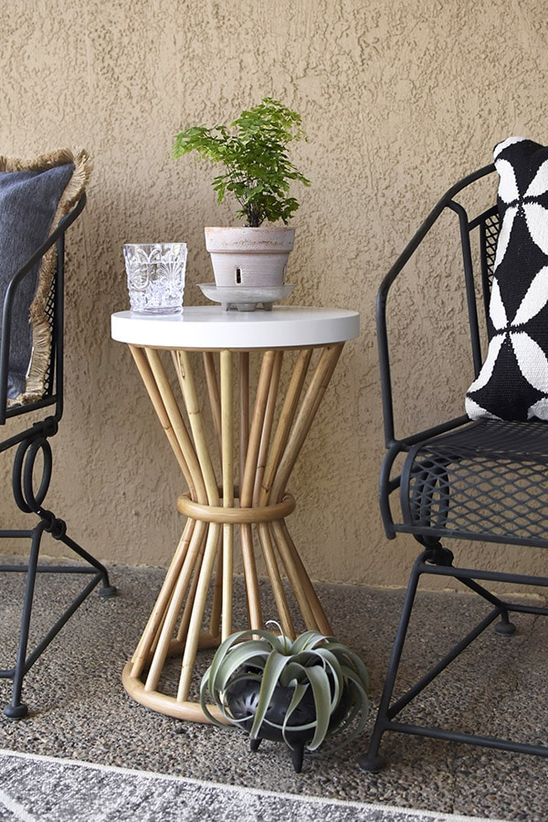 Easy Back Patio refresh, Rattan Side Table - Easy Back Patio refresh, Check out 5 simple tips for updating your outdoor space.  Learn how to get your concrete patio summer ready in no time at all! Delineate Your Dwelling #patioideas #patiodecoratingideas