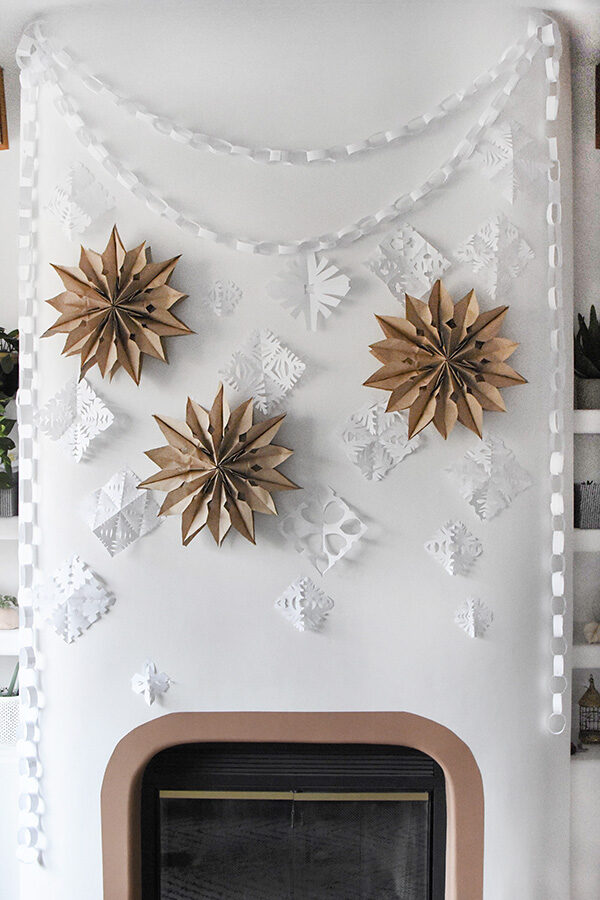 Holiday Paper Bag Stars on fireplace