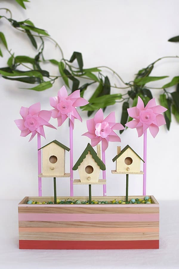 Learn how to make creative and colorful Spring Birdhouses.  They are the perfect idea for Spring Decor on your tabletop, entryway or sitting out at your next party. Delineate Your Dwelling #colorfulspringbirdhouse #colorfulbirdhouse