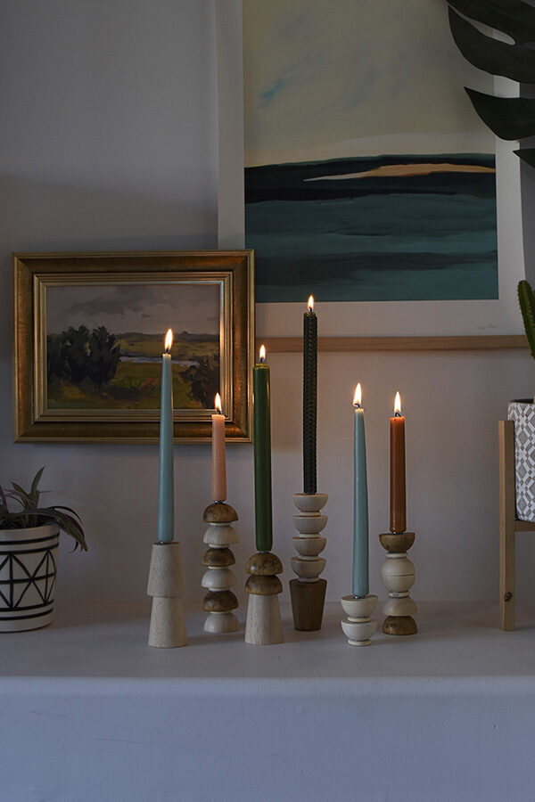 Lit Wooden Candlestick Holders at night