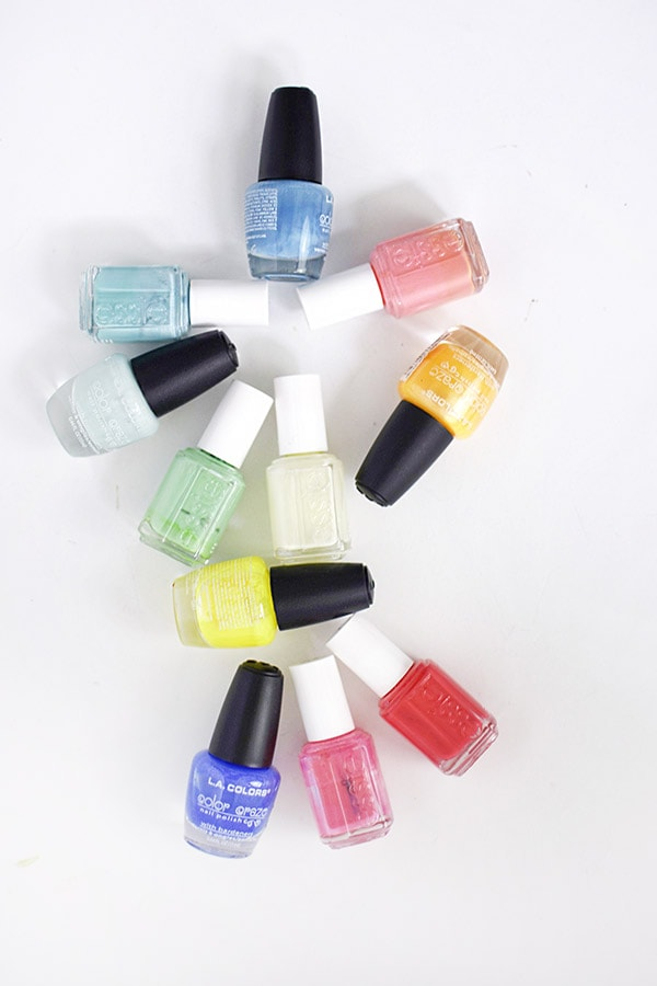 Pile of Colorful Rainbow Nail Polish
