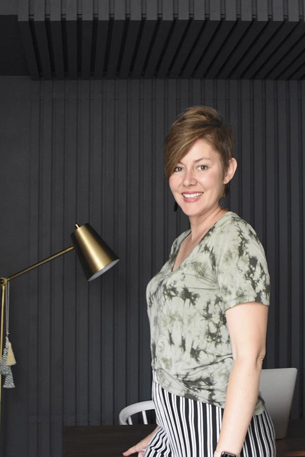 Amy Weir against Wood Slat wall