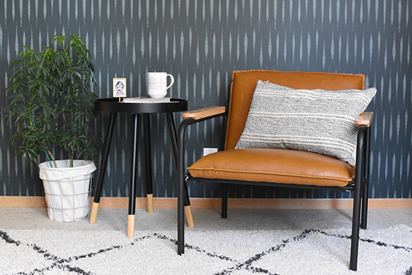 Leather chair against wallpaper