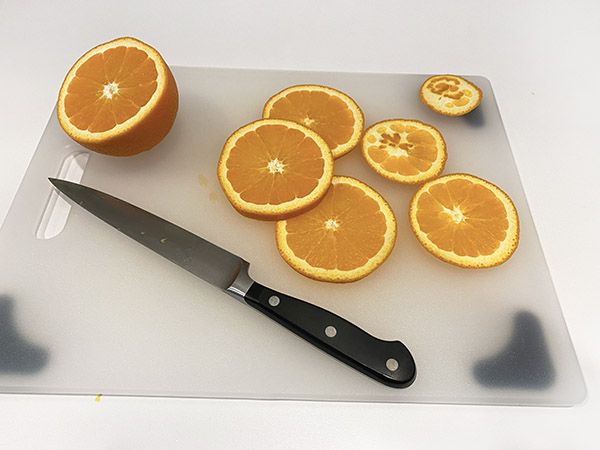 Oranges on a cutting board