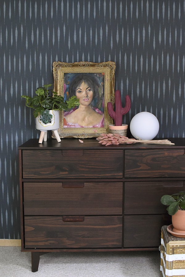 Thrifted lady art on moody teal wallpaper