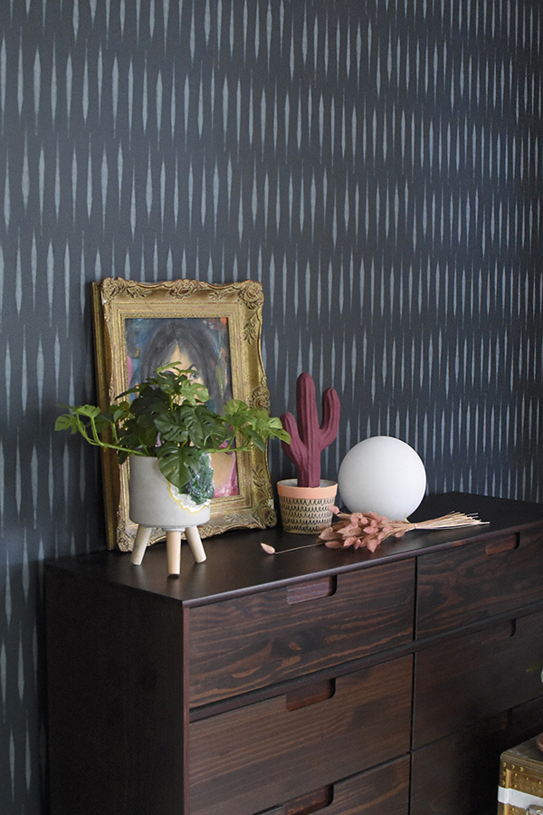Dark Teal walls with dresser