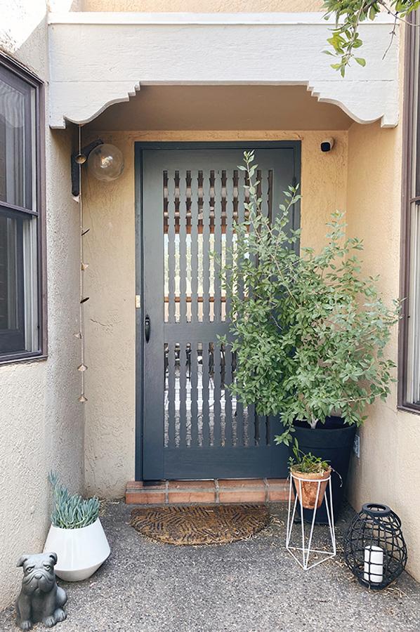 Repaired wooden front door screen
